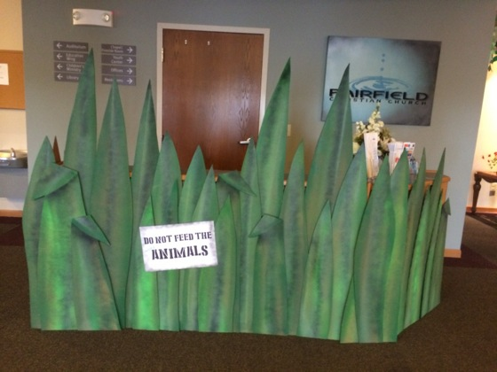 Turned our information counter into this cool area of tall grass with an animal warning.