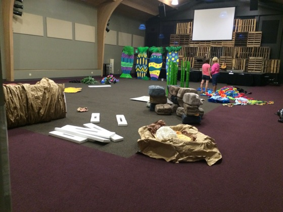 Our borrowed decorations all laid out for sorting before we pieced together our stage.