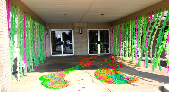 The path to enter Weird Animals VBS. Neon spray painted rocks, colored tendrils, and neon animal paw prints all guide the way into the greatness of VBS.