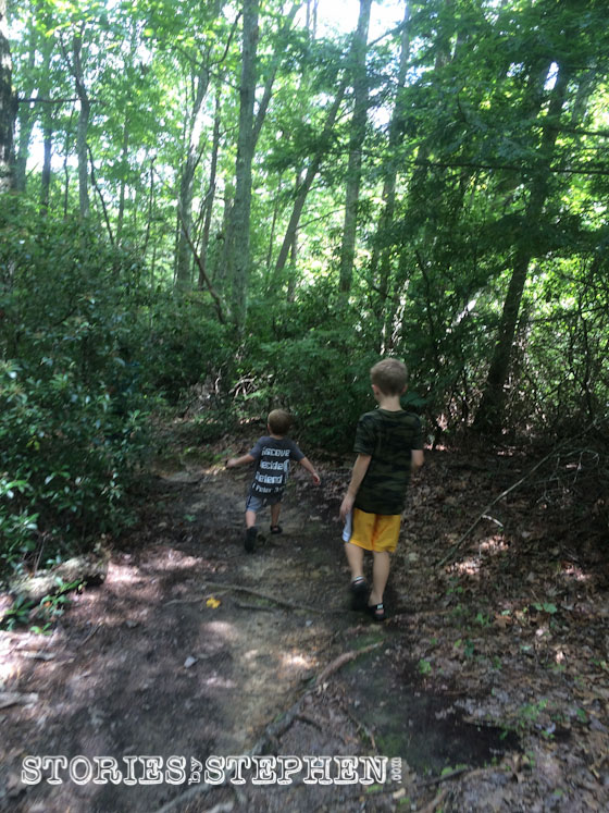 Will & Sam hiking the secret trail to Buzzard's Roost.