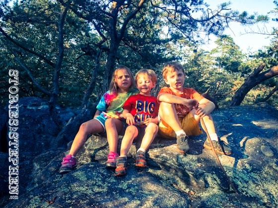 The kids climbed another boulder.