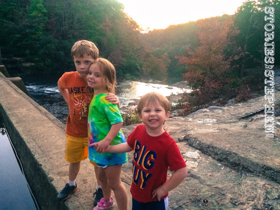 The kids standing on the dam.