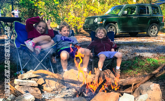 We had so much firewood leftover from the night before that we had a morning fire, which kept the kids entertained while I packed up the wet tent and sleeping bags. The wood was wet from the storms, but dry cardboard, a starter log and some lighter fluid helped it burn.