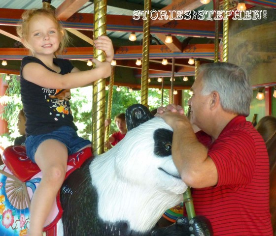 Julie Beth & Poppa on the carousel.