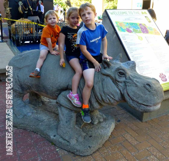 My kids riding the hippo statue.
