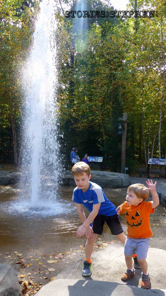 The boys dancing in front of the giant water fountain.