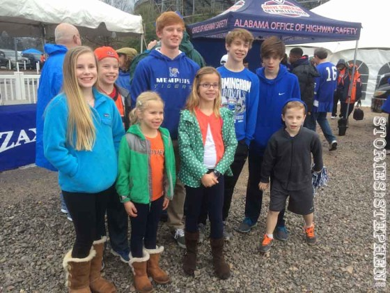 Will and his cousins at the Birmingham Bowl. Half the family was rooting for Memphis and half for Auburn.