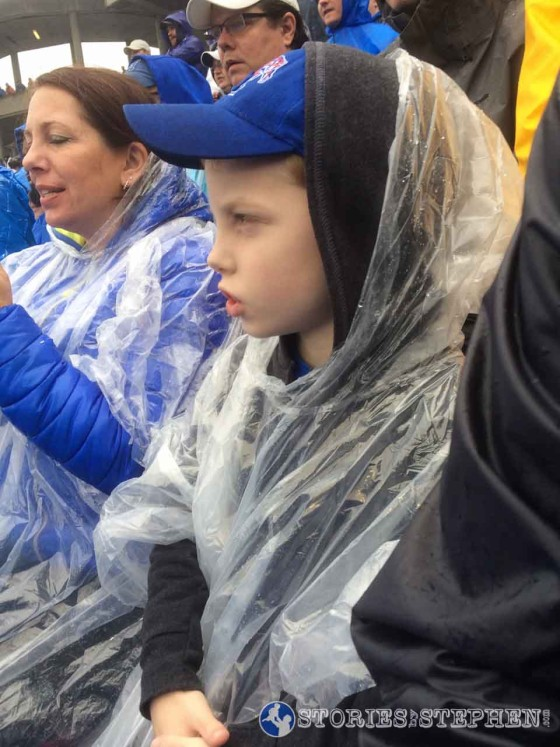 Will enduring the very rainy Birmingham Bowl in his poncho.