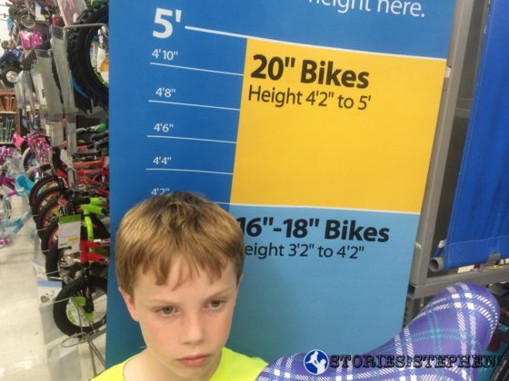 "Walmart had this nifty height chart to tell us what size bike to get. Will is at the bottom of the 20"" bike range, which means he can grow into it and use it for a few years."