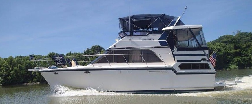 This is Nani and Pop's 37 foot Jefferson cruiser boat out on the water at Pickwick Lake.