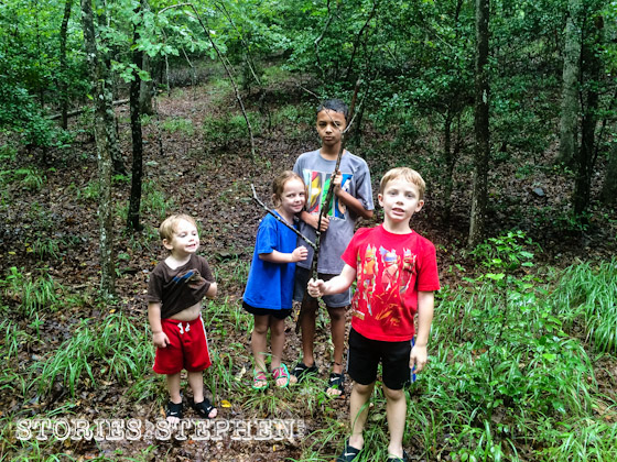 The kids were quick to explore the woods around our campsite.