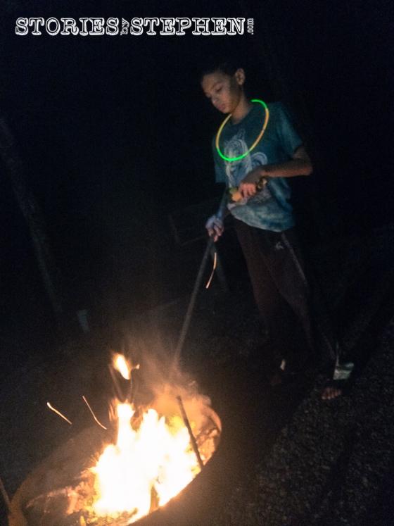 Kalon tending to the campfire.