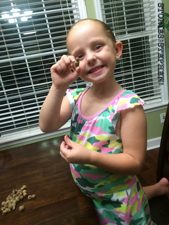"""Julie Beth showing off a """"double acorn"""" that she found."""