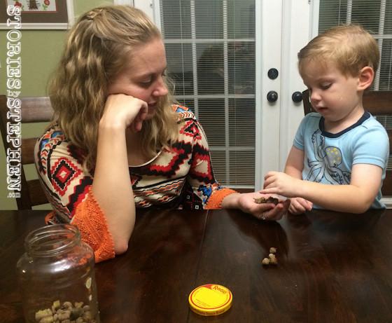 Jennifer patiently helped Sam count acorns.