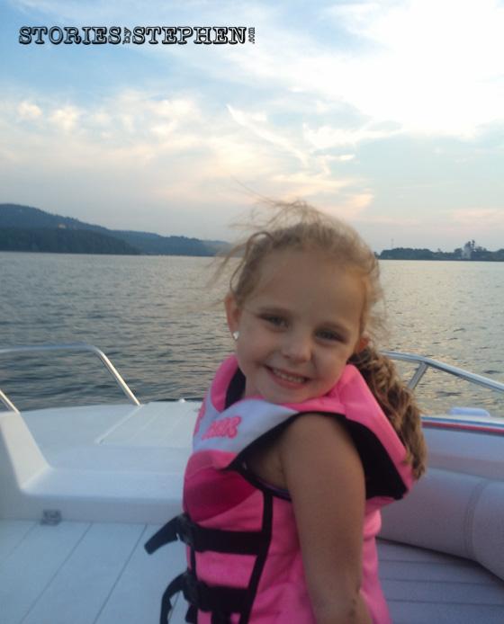 Julie Beth is enjoying the ski boat.