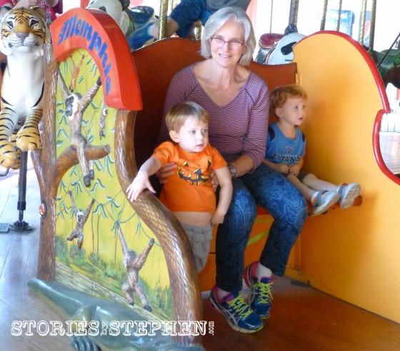 Sam, Mimi & cousin on the carousel.