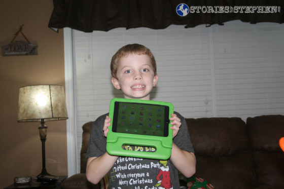 Santa brought Will an iPad Mini with a green case.