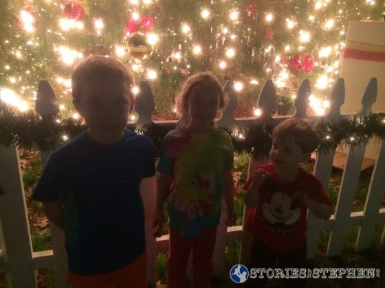 My kids in front of a giant Christmas tree in the Collierville Town Square
