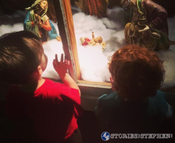 Sam and his cousin were enamored with little Baby Jesus in this Nativity.