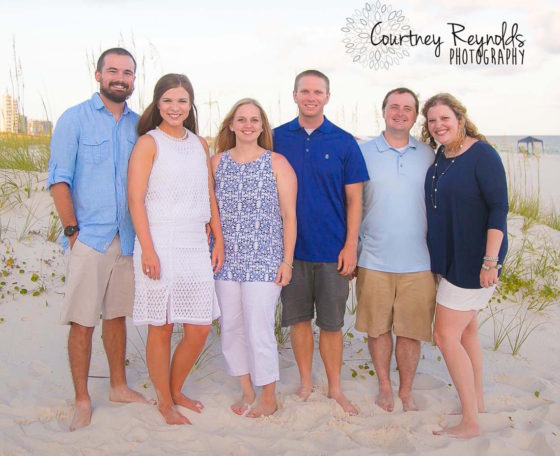 Jennifer and I are in the middle with 2 of her brothers and their wives on the outsides.. Photo Credit: Courtney Reynolds Photography